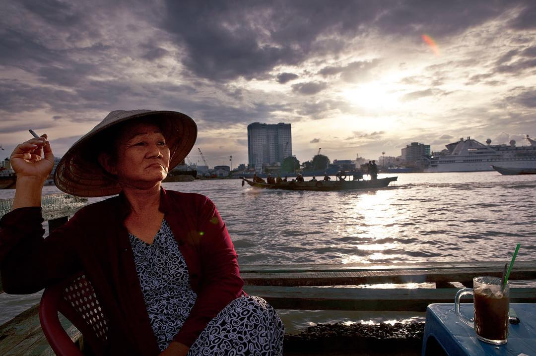 October, 2010 | Seated on a bench that used to serve customers of her riverside café, Truong Thi Tuyet Hong smokes a cigarette while recalling her neighborhood before it was subject to imminant domaine in Thu Thiem Ward, District 2, Ho Chi Minh City, Vietnam. I was lucky enough to spend 3 weeks with Hong while in the international documentary class at @brooks.institute. It was truly a special experience. I still keep in contact with her to this day. Photo by John Thomas Rose
