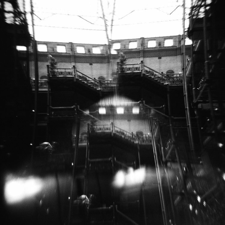 "I love Holga film cameras. They help take the ""technology"" out of photography by not having to worry about your settings too much. They are also a great introduction to 120 size format.I used a prism filter and #hp5 #film to unexpectedly capture this ghost at the Bradbury Building downtown Los Angeles #dtla . This photograph is currently in Freestyle's Employee show at our store in #hollywood #photographyourlove #colorservices #filminmyblood #holga #shootsomefilmdangit #abstractarchitecture @kloimages"